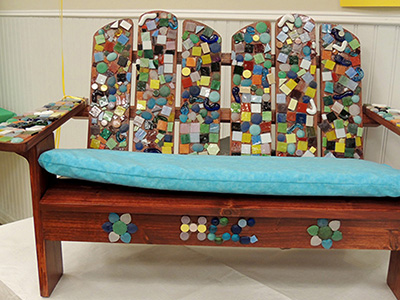 Student artwork, a mosaic covered chair